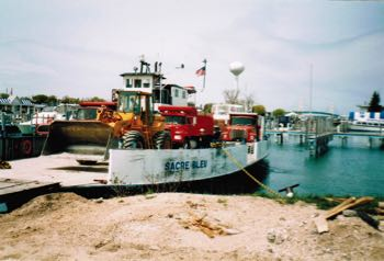 Transporting a Darrow Bros. Excavating truck to Mackinac Island